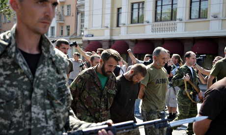 Rebels parade captured soldiers in Donetsk while Kiev marked Ukraine's independence day. Photograph: Xinhua /Landov/Barcroft Media