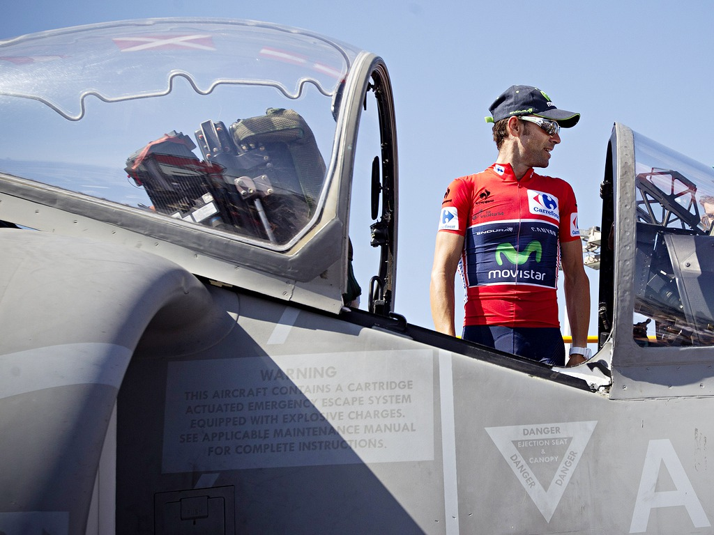 Race leader of la Vuelta, Spain's Alejandro Valverde, poses with a AV-8B Harrier II aircraft