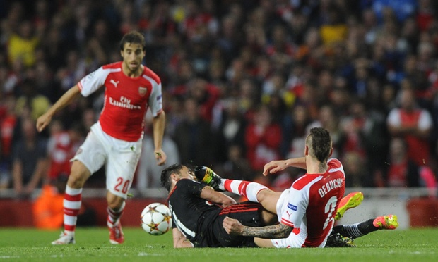 Mathieu Debuchy's clumsy challenge on Mustafa Pektemek earns him a second yellow card and an early bath.