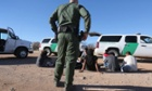 Border patrol agents with Mexican migrants.