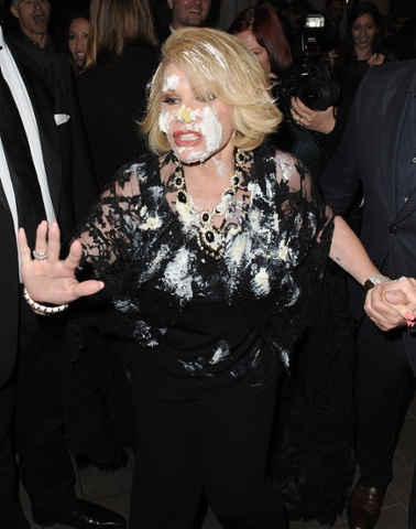 Joan Rivers runs out of the QVC Red Carpet Style- Live in L.A. event covered in cake at The Four Seasons Hotel on February 28, 2014