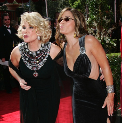 Joan Rivers and her daughter, Melissa, from the TV Guide Channel, blow kisses as they arrive for the 57th Annual Primetime Emmy Awards  Sept. 18, 2005, at the Shrine Auditorium in Los Angeles