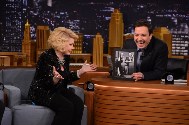 First appearance on Tonight Show after Johnny Carson banned her from the show. Joan Rivers during an interview with host Jimmy Fallon on March 27, 2014 -