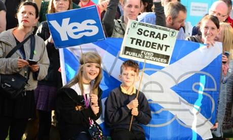 Two young 'Yes' supporters hold placards outside the Hilton Hotel in Glasgow, where Prime Minister David Cameron was addressing a CBI Scotland dinner