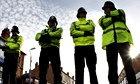 Police stand guard after a series of anti-terror arrests in Birmingham