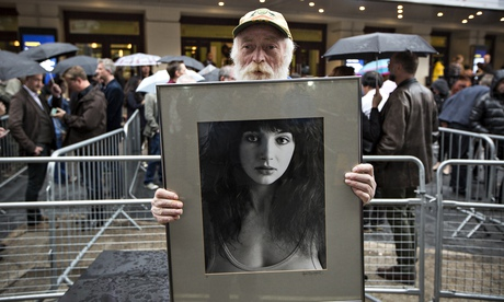 Ticketless Kate Bush fan Ian, 67, from London with his photograph of the singer outside Hammersmith