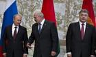 Belarusian President Alexander Lukashenko, centre, speaks to Russian President Vladimir Putin, left,