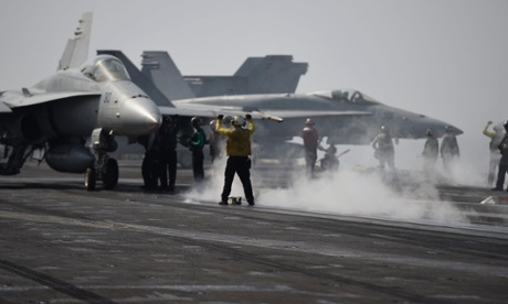 aircraft carrier USS George HW Bush us air strikes iraq