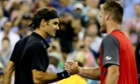 Roger Federer and Sam Groth shake hands after their second round match at the 2014 US Open.