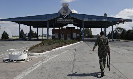 A Pro-Russia rebel walks at the Novoazovsk border crossing point, in eastern Ukraine.</em> Photograph: Sergei Grits/AP