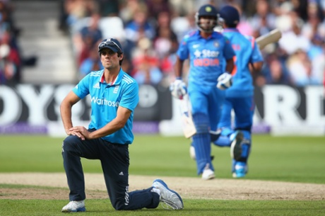 England captain Alastair Cook shows his frustration as Suresh Raina and Ambati Rayudu, in the background, notch up the runs for India.