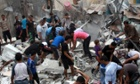 People inspect the rubble of a house in the Shati refugee camp in Gaza hit by a presumed Israeli strike, killing a girl of eight and injuring 29 others.