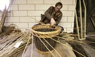 Jonathan Coate making a willow basket at PH Coate & Son on the Somerset Levels near Taunton.