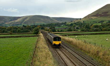 A passenger train approaches Edale in Derbyshire
