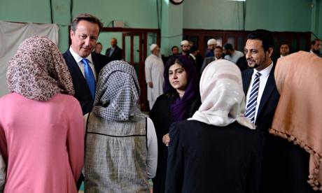 David Cameron and Lady Warsi at Jamia Masjid mosque in Manchesterus