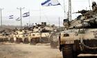 Israeli Merkava tanks withdrawing from the Gaza Strip.