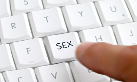 A finger pushing a keyboard button that says 'Sex' on it