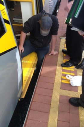 man trapped in train gap