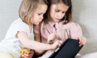 Two children with an iPad