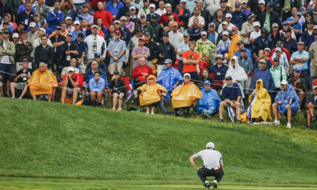 Rory McIlroy lines up his putt on the 14th green in the second round.