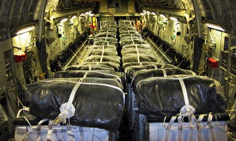 Pallets of bottled water are loaded on board a US Air Force plane for an airdrop to Iraqi refugees