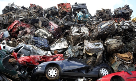 Piles of crushed cars at a metal recycling site in Belfast, Nor