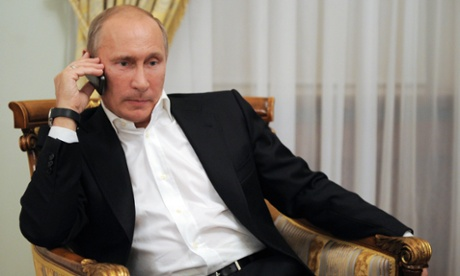 Russia's President Vladimir Putin on his phone.