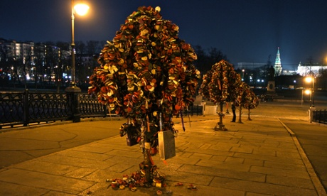 Love locks attached to metal trees on Moscow's Luzhkov Bridge.