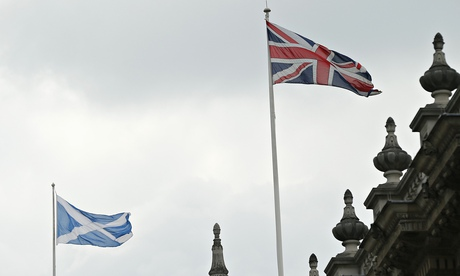 A Union Flag and Scottish Saltire fly over Britain's Cabinet Office in central London