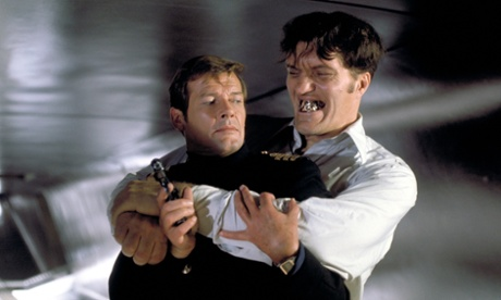Richard Kiel as Jaws getting to grips with Roger Moore as James Bond.