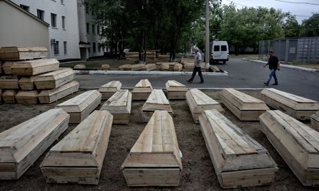 Coffins prepared for burial outside the morgue in Luhansk