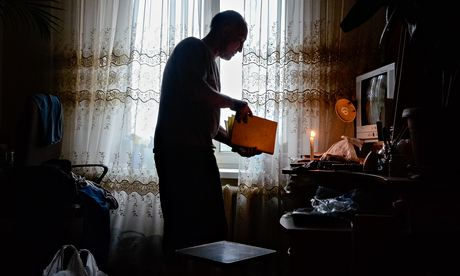 Viktor in the apartment in Luhansk he refused to leave. Photograph: Maria Turchenkova