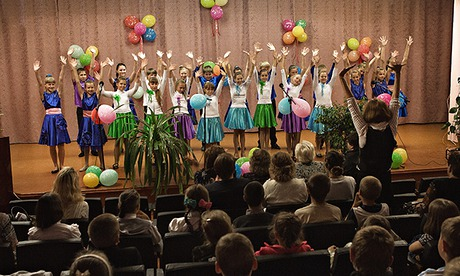 Pupils from different schools at a singing and dancing competition in Luhansk. Photograph: Maria Turchenkova