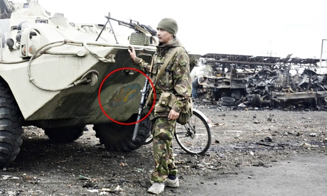 A pro-Russia soldier seen near an APC with the mark of peacekeeping troops in Lutuhyne, near Luhansk. Photograph: Maria Turchenkova/Guardian