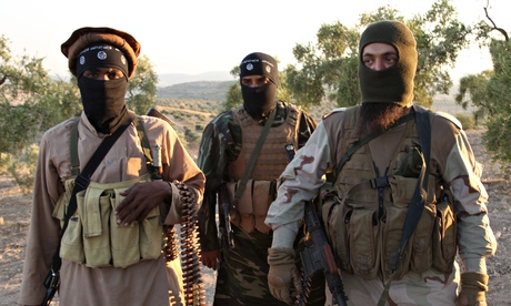 Isis militants near Aleppo in Syria in October 2013.