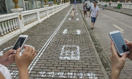 The mobile phone lane for pedestrians in Chongqing, China.