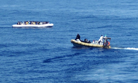 A picture released by the Italian navys shows migrants being rescued off the coast of Sicily
