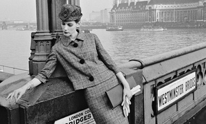 Model Judy Dent poses on Westminster Bridge in a checked skirt suit, 2nd January 1961