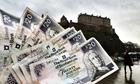 Twenty pound notes seen in front of Edinburgh Castle.