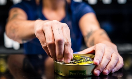 A member of staff opens a tin at Tincan