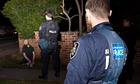 A man being arrested following the execution of search warrants across in the north-west suburbs of