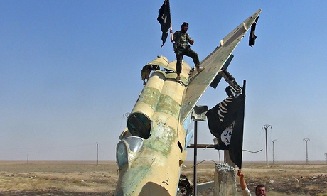 Islamic State fighters on a Syrian fighter jet in Raqqa