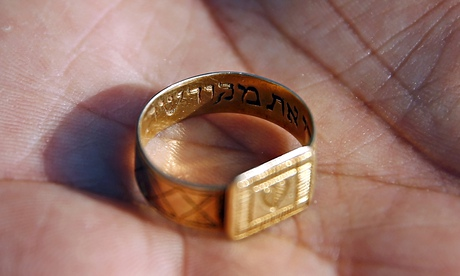 A golden ring inscribed in Hebrew unearthed at the Nazi death camp in Sobibor