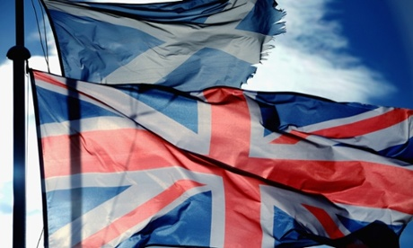 A Union Jack and Saltire flags blow in the wind near to Glen Coe on March 24, 2014 in Glen Coe, Scotland.