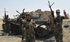 Iraqi Shia militia fighters celebrate breaking the siege of Amerli