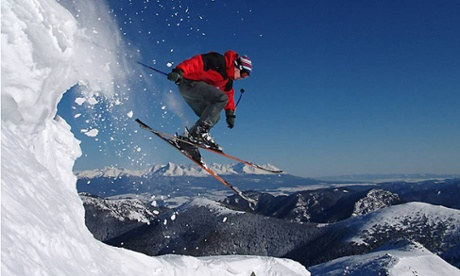 A skiier jumping down snow in the Tatra mountains in Slovakia