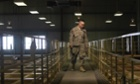 A US military guard watches over detainee cells inside the Parwan detention facility near Bag