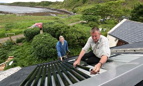 Fitting solar thermal water heaters onto the roof, Eigg