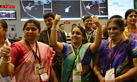 Staff from the Indian Space Research Organisation celebrate – Mars Orbiter