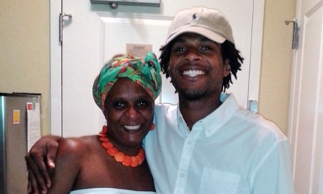 John Crawford with his mother, Tressa Sherrod.